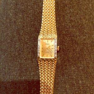 Gold and diamonds Swiss quart watch